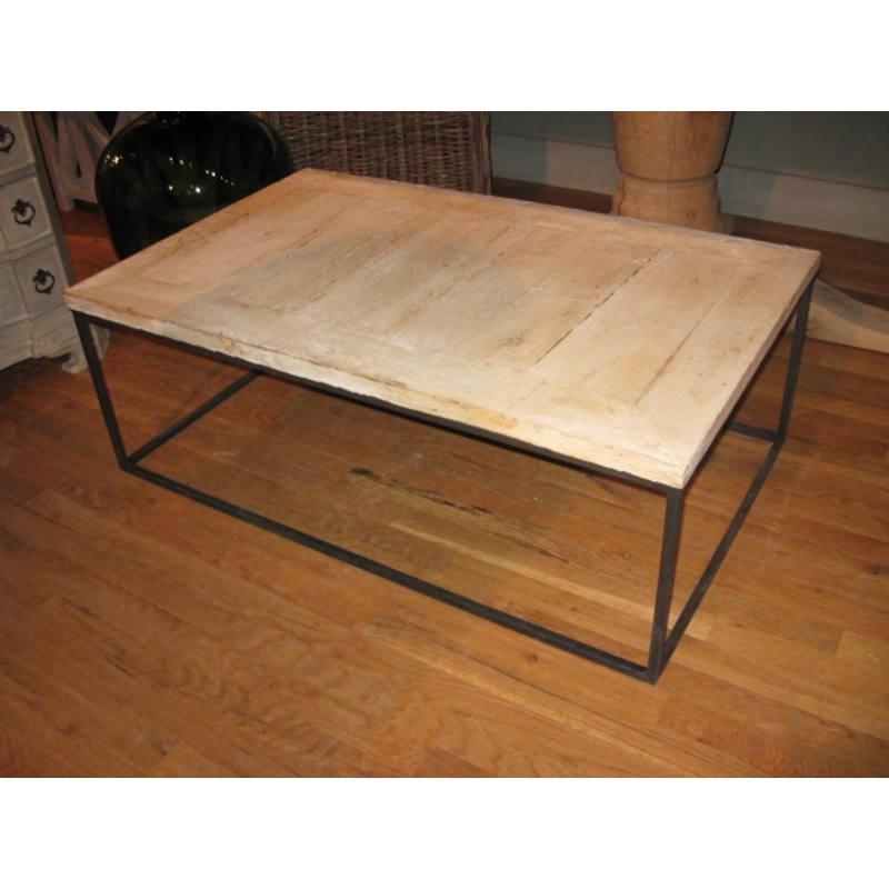 Coffee table with iron base and bleached wood top